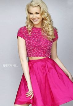 Showcase chic contemporary cool in the incredible Sherri Hill 32291 short two-piece dress. Luscious luminescent beads adorn the barely cropped top, with jewel neckline and short sleeves. The top is perfectly complemented with a fabulously flared taffeta A-line skirt with sleek waistband.
