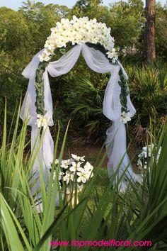 flower arrangements for wedding arches | Magnolia Wedding Arch | Unique Floral Arrangements By Rose Fisher