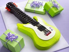Rock Star Birthday Party Caleb's next birthday cake? Rock Star Birthday Party Here's a party that rocks. Music is the centerpiece of activities and our Electric Guitar Cake is a showstopper. The birthday girl or boy will have fun with their favorit Guitar Birthday Cakes, Guitar Cake, Guitar Party, Rock Star Party, Gel Food Coloring, Frozen Cake, Betty Crocker, Sorbet, Amazing Cakes