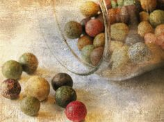 Before glass marbles became common, antique toy marbles were made from ceramics, including clay, stoneware, and china or porcelain. These were first made in America in 1884 by The Akron Toy Company. Prior to 1884 they were imported from Germany.