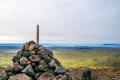 A custom in Iceland is to stack rocks into a pile, someone had created a large stack at the peak of the mountain we landed on.  A shot of the dark and rough looking terrain that made up the volcanic mountain range just outside of Reykjavik, Iceland.  || #AlexTonettiPhotography #Photography