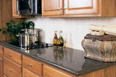 Granite Leicester inspires a sense of luxury and beauty. Beyond the use of granite in the home. Granite can take tremendous heat. There is not a pan to hot to place directly on the Granite Leicester, with no counter top burns or stains. Silestone Countertops, Granite Worktops, Quartz Kitchen Countertops, Granite Kitchen, Kitchen Cabinetry, Kitchen Worktops, Dark Countertops, Cupboards, Light Oak Cabinets