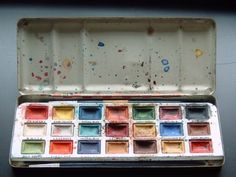 "Water color paints in a metal tin ""I remember painting out of a tin similar to this, when I was much younger.""-Katrina Westall"