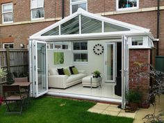 Guide to Conservatory Prices: How Much Does a Conservatory Cost? Conservatory Prices, Conservatory Dining Room, Modern Conservatory, Conservatory Interiors Small, Conservatory Curtains, Conservatory Ideas Interior Decor, Orangery Conservatory, Orangerie Extension, Conservatory Extension