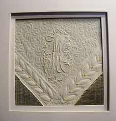 """5x5"""" framed miniature created from vintage hankie corner.  Machine quilted and hand beaded. Placed on top of Dupioni silk."""