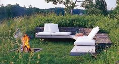 I want my firepit to look this fancy...minus the white cushions...that's just asking for trouble.
