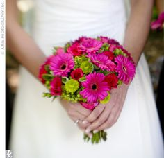 hot pink gerbera daisies accented with spray roses and Yoko Ono button mums in lime green.