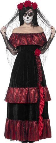 Questo travestimento da sposa lugubre messicana per Halloween comprende un vestito e un velo (make-up non incluso). L'abito è lungo, con taglio impero, scollo a barca e balze nella parte inferiore. Esso è in tessuto tipo velluto nero e raso di colore rosso, con una sovrapposizione di pizzo nero. Inoltre, sul fianco è presente una lunga fascia plissettata, decorata da una rosa di stoffa. Il velo di pizzo nero completa quest'abito che ci ricorda la tradizione messicana del Dia de los muertos.