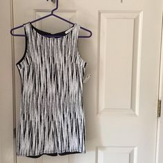 Black & White Romper Never Worn and tag attached!!!! Size small. Perfect for layering under a skirt or pants or shorts!! Black and white. Size small bit could fit a medium. Perfect condition super comfortable and breathable. Peekaboo opening on back (pictured) Other