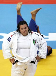 Mexico's Vanessa Zambotti (in white) reacts after defeating Brazil's Claudirene Cezar in their women's plus 78kg final match at the Rio de Janeiro International Grand Slam judo tournament. (Reuters)