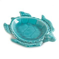 Put a turtle on the table and watch your guests delight over it! This gorgeous porcelain decorative dish looks like a swimming turtle with fantastic features and a shallow central basin, all finished