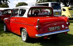 Ford Anglia Red. Dad had one of these and I can still remember the reg 320 KDE.
