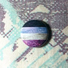 A glitter version of the asexual flag! This fun glittery asexual pride design is available as a 1 or 1.75 pinback button or 1 magnet. This