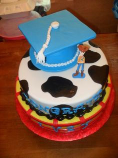She loves toy story..grad cake..it's what they want now instead of school colors