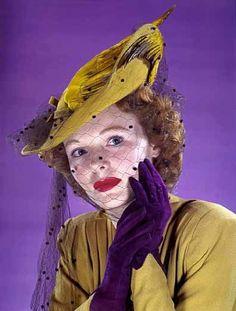 mustard yellow bird hat with purple veil.