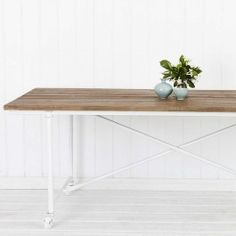 An attractive table with an industrial look, crafted from recycled elm and paired with iron legs, castors and cross bars finished in an aged white effect. Home Office, Office Desk, Dining Room, Dining Table, Parisian, Entryway Tables, Outdoor Furniture, Kitchen Ideas, House
