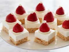 Get Santa Hat Crispy-Treat Cheesecake Squares Recipe from Food Network