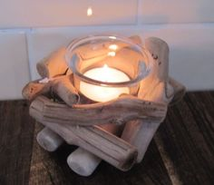 driftwood tea light, mini campfire.... this could be assembled with beach findings :)