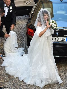 There she is: Elisabetta Canalis beams in white wedding dress in Italy on Sunday...