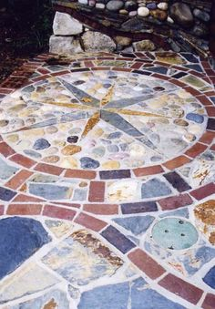 I'm liking the incorperation of the big lumps of stone.  This would save me a LOT of time if I come up with an idea that will work... http://www.mosaicmosaic.com/