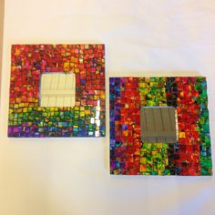 Mosaic mirrors made with glass painted with alcohol ink, then cut into mosaic squares.  Gorgeous colors.