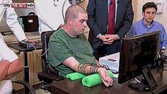 A medical first: Quadriplegic man controls arm using a chip implanted in his brain