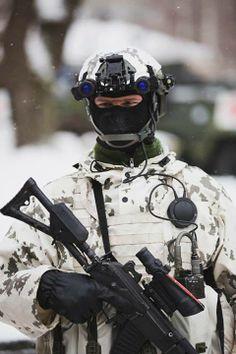 Finnish elite Jaeger in winter gear and SAKO RK 95 TP rifle.