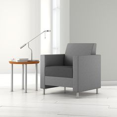Composium Sharp club chair, Momentum Infinity Pewter shell; Momentum Infinity Graphite (seat); Mezzanine Occasional round table, medium cherry finish