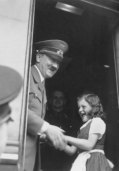 1938 photo of Hitler with a child. That's Heinz Linge lurking in the background in the photo. His book about Hitler was excellent and shed much light on him as a human being. (via putschgirl)