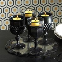 spray paint some cheap goblets from the thrift store  black goblet candle holders