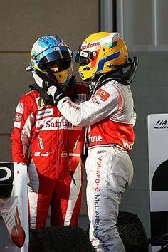 (L to R): Race winner Fernando Alonso (ESP) Ferrari celebrates with third placed Lewis Hamilton (GBR) McLaren in parc ferme.  Formula One World Championship, Rd 1, Bahrain Grand Prix, Race, Bahrain International Circuit, Sakhir, Bahrain, Sunday, 14 March 2010