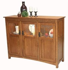 Amish Old Century Display Buffet The Old Century features fine solid wood with an attractive display case. A beautiful buffet to display and store treasured items. You can customize and have it built in choice of wood and stain. #buffet #diningstorage