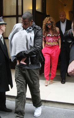 Jay Z and his wife Beyonce are leaving Fouquet's Hotel in Paris with their son blue Ivy Carter  Paris