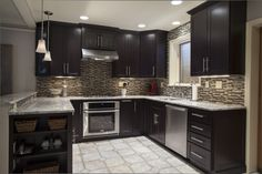 A medium kitchen with dark cabinets and light floor make for a classy kitchen