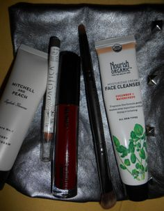Ipsy September: Mitchell and Peach Hand Lotion, Pacifica Eyeliner in Gunmetal, Cailyn Lip Gloss, Crown Duo Sided Brush, and a Cleanser.