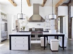 Paige Schnell of Tracery Interiors' airy Alabama lake house, filled w/ reclaimed oak beams and flooring. Photo © Jean Allsopp #besthomekitchen #foodandwine