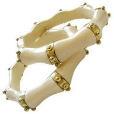 vintage pair of gold and ivory bangles.