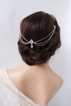 This is a Silver,crystal headpiece with delicate drapes of silver plated chain. Perfect for a Bohemian look when worn with hair flowing down,or if you style your hair up, it gives a lovely Vintage Wedding Look.  It is attached with little combs that are hidden under the diamond shaped motifs, and there are little loops as well, for putting hairpins through for extra hold. It is very light and delicate.  Lovely for a Bride, but also great for Bridesmaids or your Maid of honor, or for wearing…