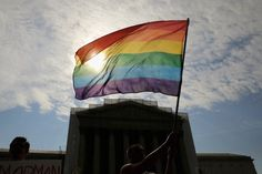 Today is an amazing day!!!! Equal rights for everyone!!!!!! A gay rights activist waves a flag in front of the U.S. Supreme Court building June 24, 2013. (Win McNamee/Getty)