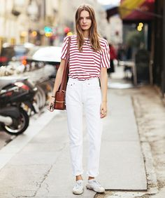 Tuck a white striped t-shirt into high-waisted white jeans with white sneakers for a fresh summer to autumn look. // #Fashion #Style