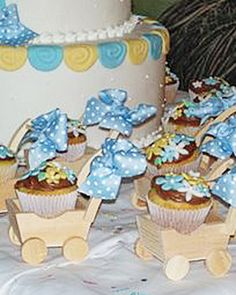 """Baby Buggies"" Your Best Baby Shower Cupcakes:   Simple decorated cupcakes get to ride in their own baby buggies. Later, guests can take them home as party favors."