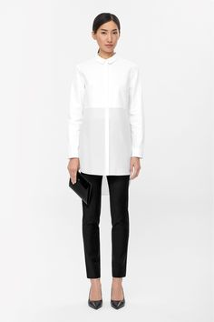 Made from textured cotton, this shirt dress has a fluid silk skirt for a modern tactile contrast. A clean straight shape, it has a narrow collar, long sleeves and a hidden button fastening along the front.