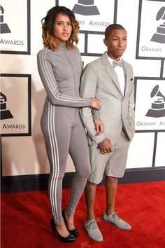Pin for Later: Menswear Was the Grammys Red Carpet's Strong Suit Pharrell Williams The singer kept it casual as he walked the red carpet, trading in the typical tux for a reflective Adidas shorts suit.