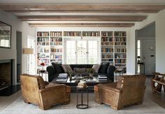 Gorgeous living room/library in the home of Michael C. Hall in Los Angeles