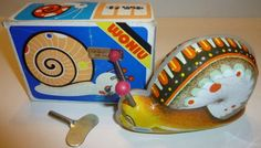 Woniu Tin Wind Up Snail Toy 1970s by thecollectiblechest on Etsy  #Tin #Toy #Snail