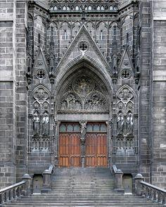 Main entrance of the Cathedral, builded in volcanic stone, of Clermont Ferrand, Auvergne, France