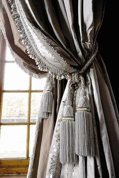 Layered classical drapes  Grey and taupe with multiple tassels.  elegant traditional interior design
