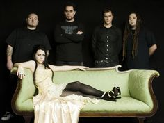Evanescence-more specifically Amy Lee...vocally she gives me something to sing along with that doesn't force a lot of adjustment from my natural voice so YAY!  Not to mention her voice alongside those dark strains of instrumentation are just gorgeous ^-^