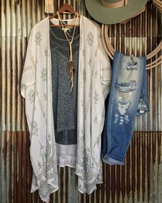 The Corder duster is finally back in stock ladies!!! We just can't get enough of its teal and sand paisley details! #ourkindofstyle #summer #savannah7s