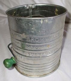 I just love antique kitchen utensils! They don't make them like they used to..  Old Tin BROMWELLS Measuring SIFTER by GussiesEmporium on Etsy, $6.95